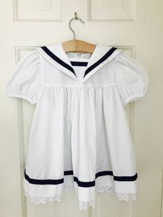 A personal favorite from my Etsy shop https://www.etsy.com/listing/516004920/vintage-girls-dress-size-4t-sailor-dress