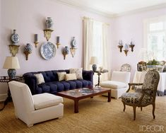 Effortlessly Chic: The East Hamptons living room of Estée Lauder global creative director Aerin Lauder features a collection of her visionary grandmother's blue-and-white Chinese porcelain.
