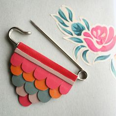 Faux Leather Scallop Triangle Kilt Pin Brooch in Pink, Orange and Sage. $28.00, via Etsy.