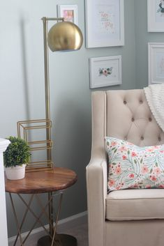 Gorgeous styling in this nursing/rocking corner of the nursery!