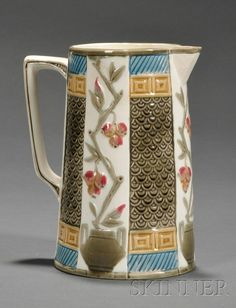 Wedgwood Argenta Majolica Pitcher, England, c. 1884, molded and enameled with alternating panels of fruits and plant pots and fish scale designs, impressed mark, ht. 7 1/2 in.  |  SOLD $296