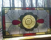 Rainbow Transom stained glass window panel vintage plates.  via Etsy.