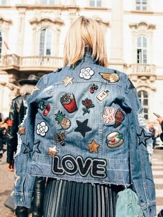 A jean jacket with patches on patches. / Click for more street style.