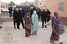 In this photo taken Tuesday, Dec. 10, 2013, Western Saharan women confront riot police in Laayoune, the capital of the disputed territory of the Western Sahara. (AP Photos/Paul Schemm) ▼1Jan2014AP|Tensions high in Western Sahara despite new plan http://bigstory.ap.org/article/tensions-high-western-sahara-despite-new-plan #Laayoune