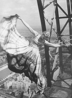 Lisa Fonssagrives on the eiffel tower, 1939, photograph by Erwin Blumenfeld.