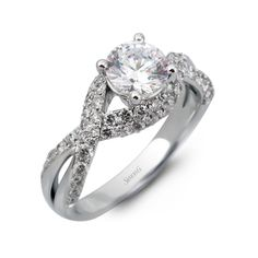 Fabled Collection ? This gorgeous 18K white engagement ring is comprised of .81ctw round white Diamonds. ? DR253