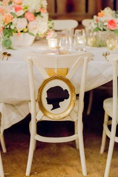 A gold framed silhouette for the bride's chair adds a regal look to your décor. Source: Olivia Smartt #framedsilhouette #weddingsigns