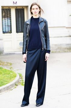 Try a leather jacket and crewneck sweater with your wrap pants for an understated and cool look.