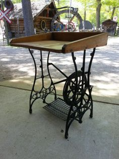 One of a kind desk made from an antique sewing machine base and dough board top.