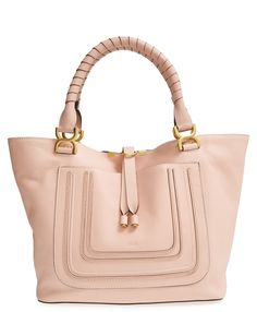 All of the stylish essentials are going in this beautiful, blush-hued Chloé leather tote.