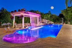 Backyard Resort with Fiber Optic Pool Lighting mediterranean swimming pool
