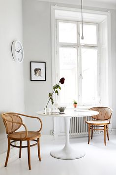 bentwood armchairs and tulip table. white everything.