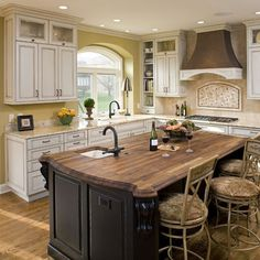 Maple butcher block- black with antique white cabinets. It's my kitchen.