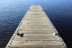 This is a neat perspective of a boat dock on a lake.