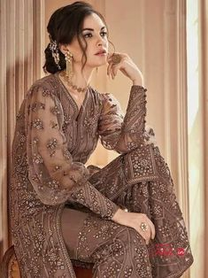 Dusty Brown Heavily Embroidered Festive Palazzo Suit very delicate designer embroidery with zari and thread work with stone embedded detail over its net top paired with matching ghera embroidered n. Kurti Sleeves Design, Sleeves Designs For Dresses, Sleeve Designs, Blouse Designs, Pakistani Bridal Dresses, Pakistani Outfits, Indian Dresses, Indian Outfits, Kimono Fashion
