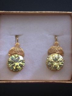 Handmade gold and citrine earrings from the small puebla of El Grullo, Mexico