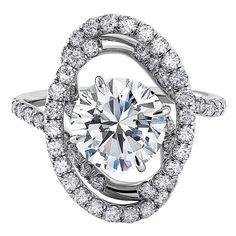 Platinum ring with diamond swirls orbiting the center stone by Danhov