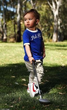 Adelaide toddler Sam Blewett practices his golf swing
