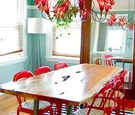 teal/blue walls with red chairs!