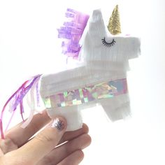 Join StuffDOT to find party decor and DIYs like these adorable Mini Unicorn Piñatas via Etsy.