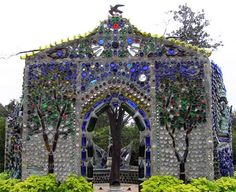 Bottle Chapel -- Constructed as a garden retreat this recycling wonder is located at Airlie Gardens, Wilmington, NC, and has been constructed entirely from recycled bottles, cement and chicken wire by local artist Virginia Wright-Frierson. Bottle House, Bottle Wall, Bottle Garden, Glass House, Virginia, Recycling, Bottle Trees, Recycled Glass Bottles, Plastic Bottles