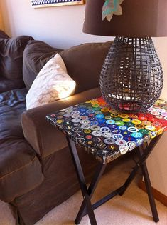 Love the lapmshade and Bottle Cap Spectrum Folding Table by TheArtofDrinkingBeerBottle Cap Spectrum Folding Table Cool idea for an old tray table!This Bottle Cap Spectrum Folding Table is just one of the custom, handmade pieces you'll find in our sho Bottle Cap Table, Beer Bottle Caps, Bottle Cap Art, Beer Caps, Bottle Top, Beer Cap Table, Beer Cap Art, Bottle Cap Projects, Bottle Cap Crafts