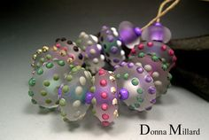 A highly decorated set of beads with fabulous colors and designs. These beads are etched. They have 3/32 holes. Of course, annealed from flame to kiln.