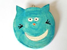 Ceramic Teal Cat Ornament Turquoise Animal Pottery Smily Face For Kids with White Teeth via Etsy