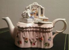 """RARE small CARDEW DESIGN TEAPOT IN THE STYLE OF A WOMAN'S VANITY Up for auction is the Paul Cardew lady's design dressing table small teapot with lid. In excellent condition. Adorable teapot with tissues, a perfume bottle, and a book with a hairbrush sitting on top of a lady's dressing table. No chips, cracks or scratches.  The collectable teapot is about 6"""" long, 4"""" high, and a little over 2"""" wide.  Made and purchased in England. Unusual and beautiful piece."""