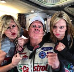 John Force teaching the girls to get pumped for their race.