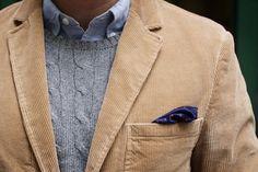 blue button-down shirt, grey cable knit sweater, khaki corduroy blazer, layering, pocket square, navy