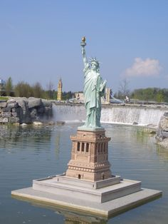 The Lady of the Harbor and the Eiffel Tower in Minimundus, a miniature park with more than 150 1:25 miniatures on the Wörthersee, Klagenfurt, Austria - Bizarre Replicas of the Statue of Liberty and the Eiffel Tower