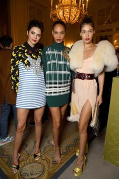 Kendall Jenner, Joan Smalls, and Bella Hadid attend the Miu Miu Cruise Collection show as part of Haute Couture Paris Fashion Week.