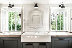 From towel bars to medicine cabinets repurposed as spice cabinets to recessed soap niches, here are a dozen ideas for tidying up the kitchen.