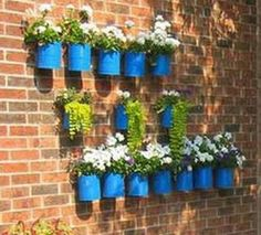 Tin can flower pots can be attached to a wall. I also put a small succulent in a small tin can as a party favor.