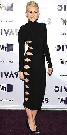 Miley Cyrus | black turtleneck dress w cutouts