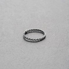 MOUNT LAVINIA BRAIDED RING OXIDISED // Braided, matt-finished oxidised sterling silver ring. // We think this KINSFOLK piece works for men too. // The simple, yet substantial Mount Lavinia collection comprises fine rings featuring different designs and a variety of precious metals. Wear them alone or combine them with something from your jewelry box, or other rings of the Mount Lavinia collection. This oxidised ring goes very well with a rose gold-plated sleek ring. // shop.kinsfo.lk