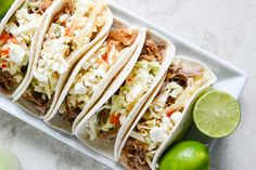 Pulled Pork Tacos with Sweet Chili Slaw I howsweeteats.com  @Brooke Tindell for your mexican night! Get a pork shoulder, it would be a cheap meal!