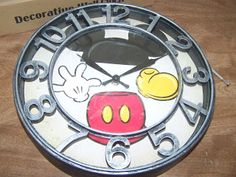 How to jazz up a basic or cheap clock.  I made this one match my Mickey Mouse kitchen.