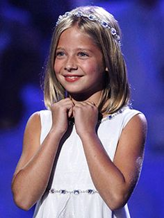 Jackie Evancho, beautiful little singer.  Fantastic voice.  She may be young, but she'll definitely be a classic!!