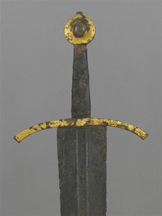 "This sword could arguably be a Type XVI or a XIV. Due to it's length and diamond cross section above the fuller I have opted to include it in Oakeshott's Type XVI.  Reign of Jean II of France (1350-1364), reign of Philippe VI (1328-1350) Lettering in gilt brass in the central fuller: ""Nulla de virtutibus tuis major clementia est"" (""None of your virtues are greater than clemency""). Overall length: 97 cm (38.2"")…"
