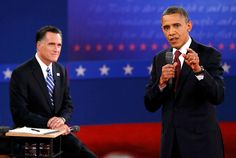 97 - 10/16/12 - President Barack Obama, right, answers a question from an audience member in front of Republican presidential nominee Mitt Romney, left, during the second U.S. presidential debate in Hempstead, N.Y., on Oct. 16, 2012. (REUTERS/Rick Wilking)