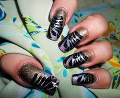 Holographic China Glaze polishes (3) sponged, then stamped in black & gold by Rita Korn 7/6/13,