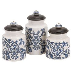 Perfect for stowing dry ingredients in the kitchen or craft supplies in the den, this lovely canister set features hand-painted finishes in blue and white.
