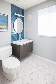 Midcentury Modern Eichler Bathroom featuring Heath Tile, White Hexagon Tile Flooring, and European Vanity and Faucet. Design by Destination Eichler.
