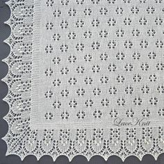 """This nature-inspired square shawl is worked in all-over lace. The style of the lace motifs is based on traditional Estonian techniques. The main square part of the shawl has a simple, yet charming floral design which creates a """"glade."""" The edge worked around the main square represents a"""