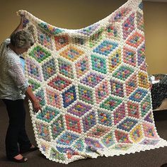 Stunning yo-yo quilt at quilt guild tonight! Carol worked on it for 14 years off and on and finished it recently! #quilt #yoyoquilt