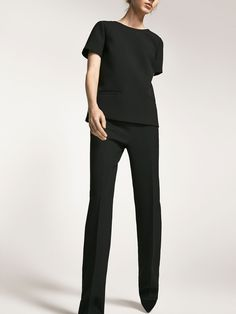 Black trousers made from a delicate blend of fabrics. Wide-leg cut, invisible side zip fastening, two side pockets and two welt pockets at the back.