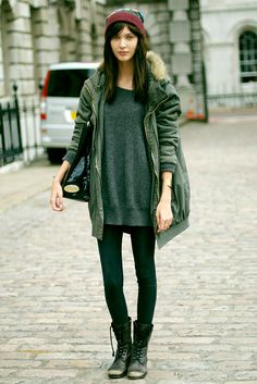 I love a good olive jacket over a chunky knit.  Even on those not so cold days, wear it open show off that knit.  Worn out army boots with leggings just make this look perfect!!