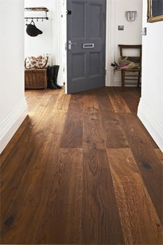 Because of its timelessness, hardwood is an ideal option for living room flooring. Even if your decor changes beyond time, hardwood stays in style. Living Room Hardwood Floors, Hardwood Floor Colors, Dark Wood Floors, Engineered Wood Floors, Bedroom Flooring, Wood Walls, Living Room Decor Cozy, Paint Colors For Living Room, Cozy Living